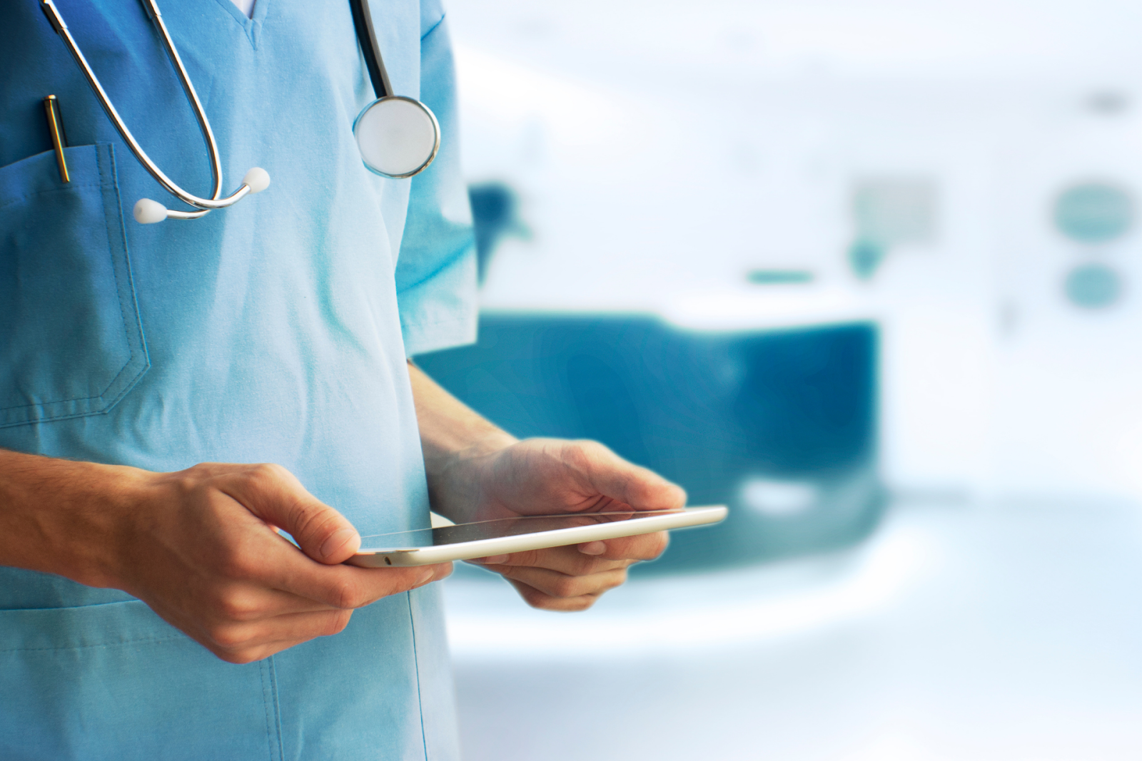 medical worker holding tablet