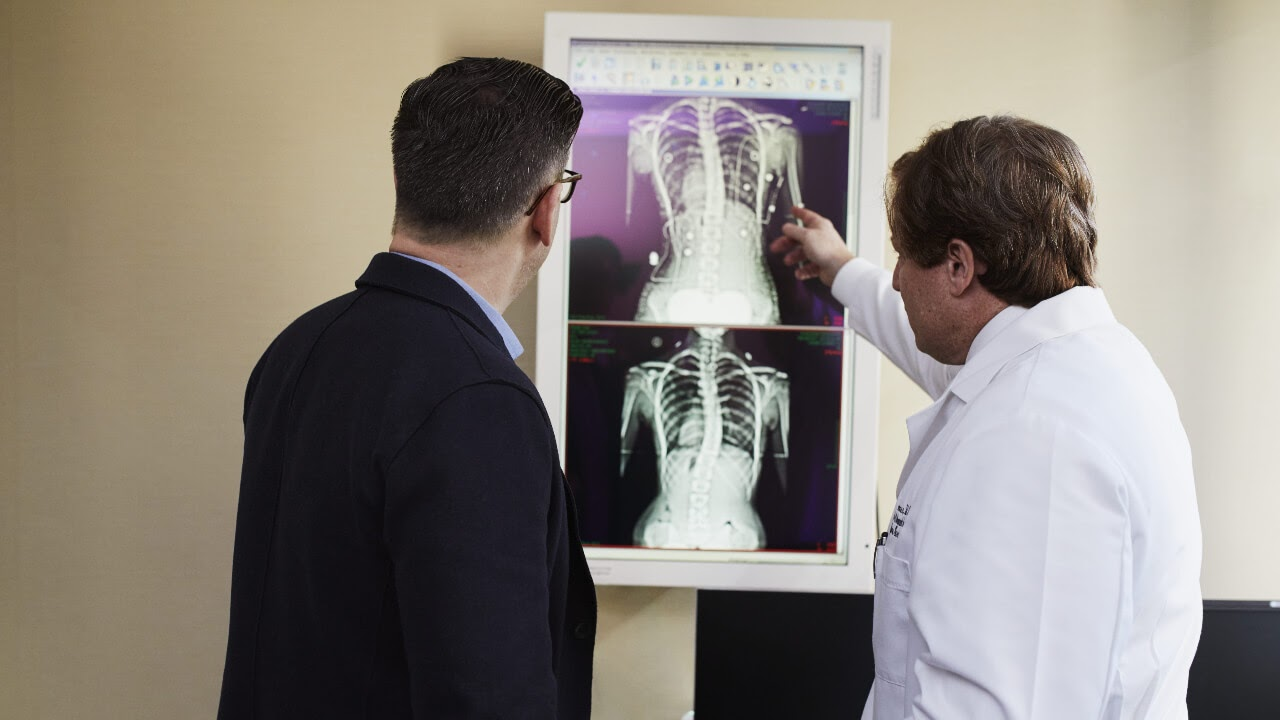x ray test results conversation man in suit man in white lab coat