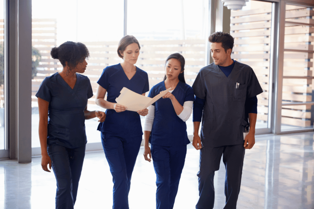 medical staff coworkers looking at files questioning group discussion hospital