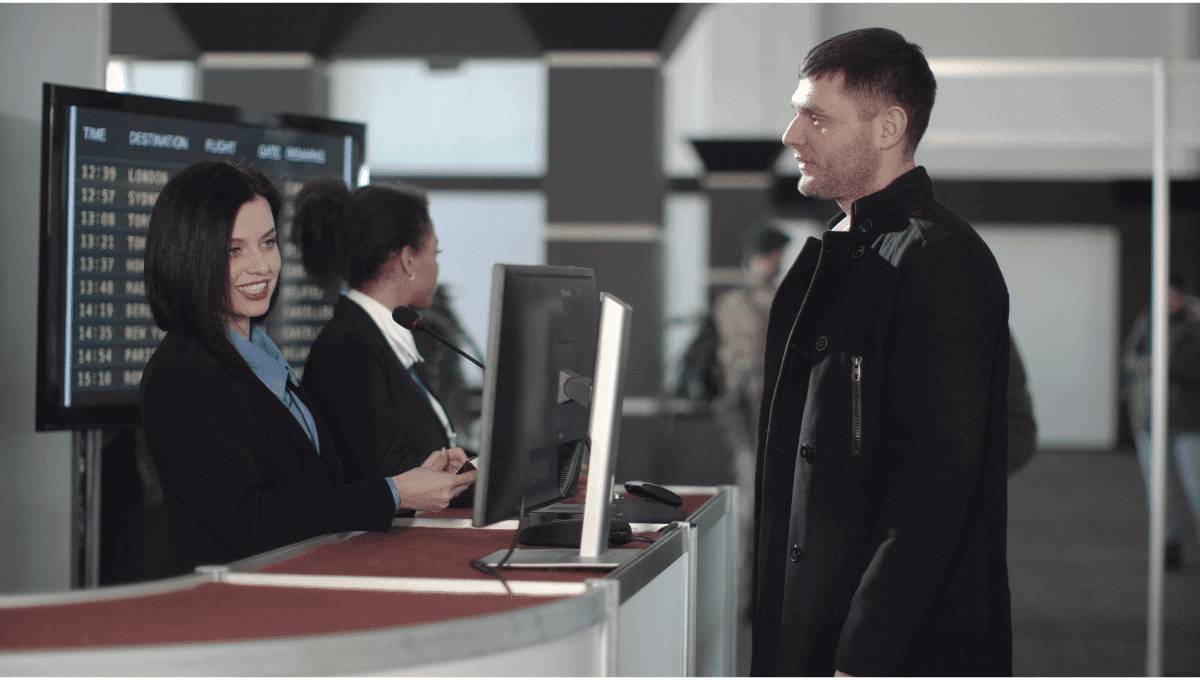 man at airport security checking passport credentials airline worker computer