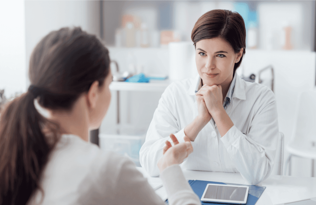 patient consultation listening doctor's office ipad lab coat healthcare technology