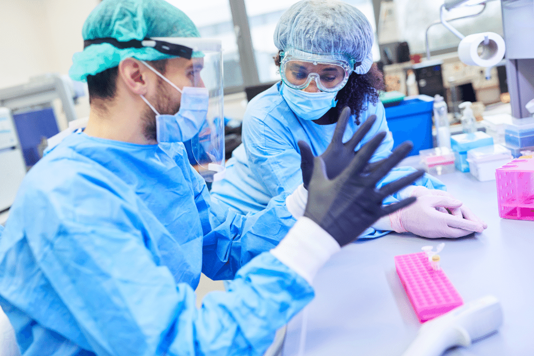 data lab test tubes gloves man and woman scientist hairnet research shield pink machinery goggles