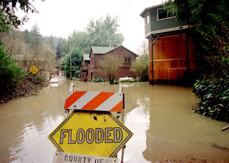 Flooded sign image via 89.3KPCC