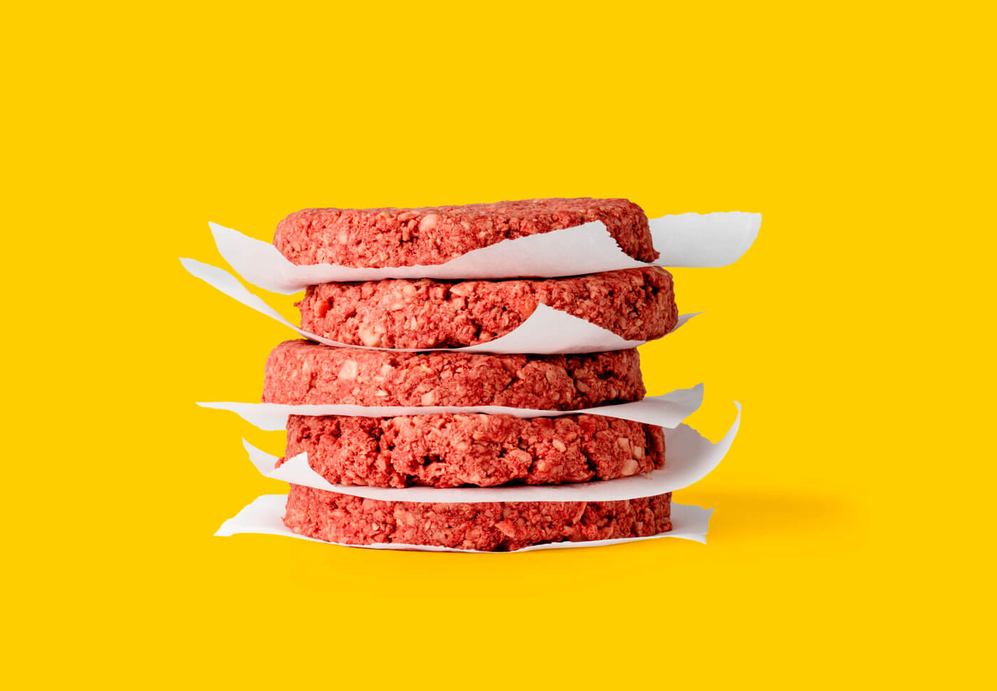 Raw Impossible Burger patties that look like real meat