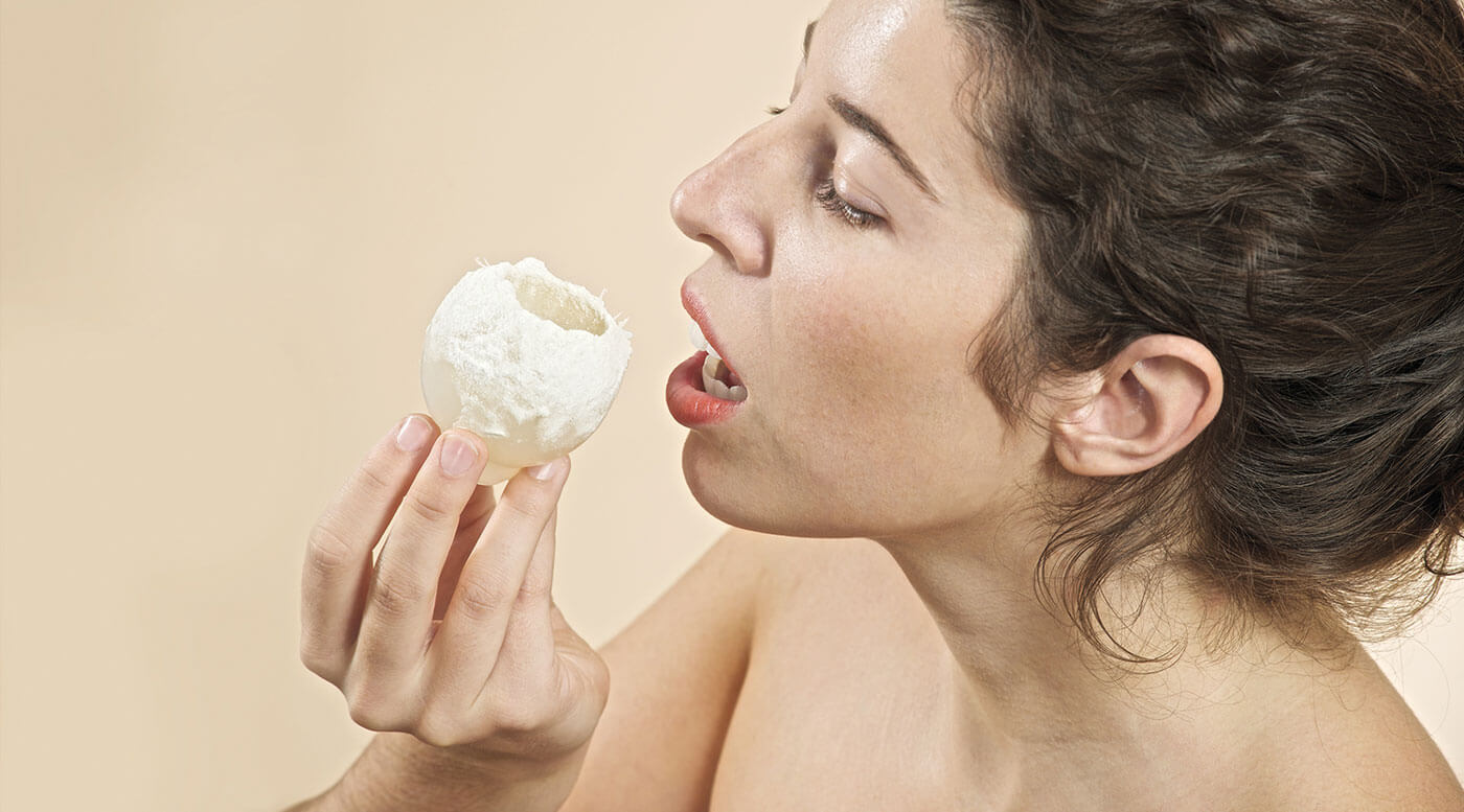 Woman eating edible fungus grown on toxic plastic waste