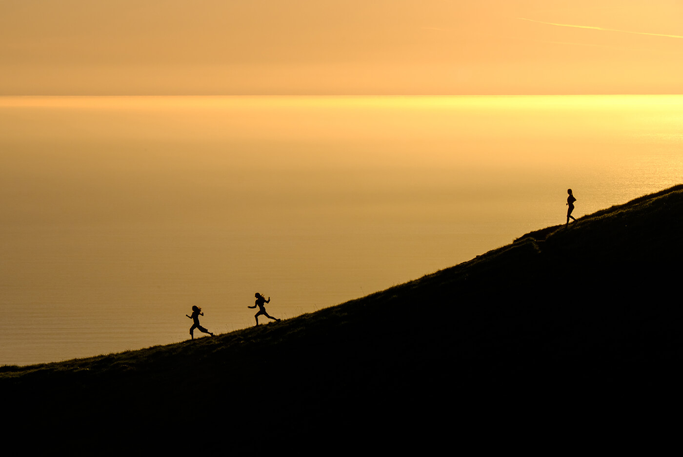 Women running downhill