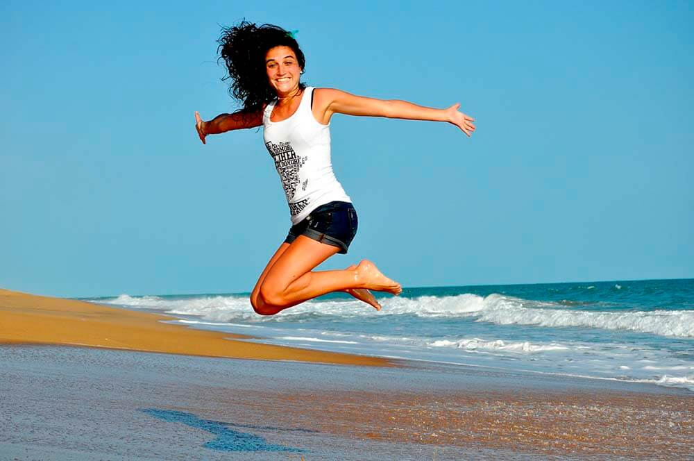 girl happy jumping