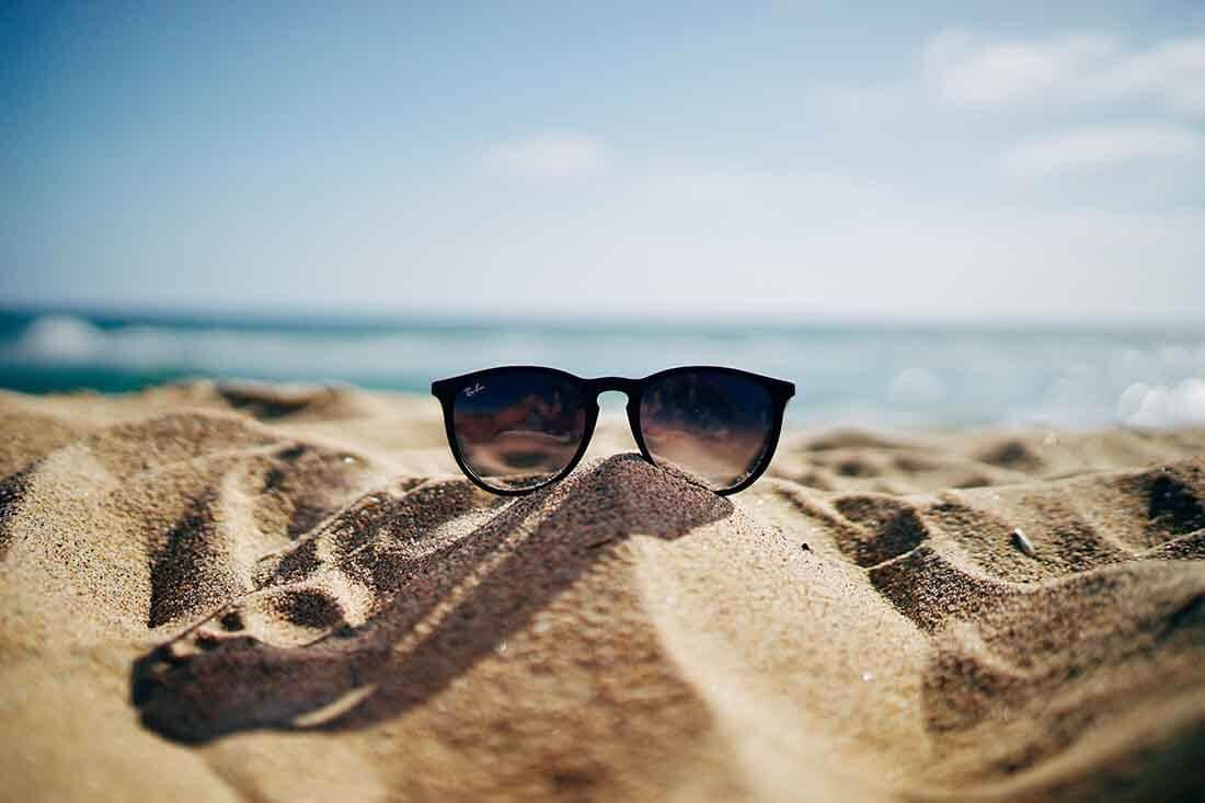 Sunglasses on a sunny beach