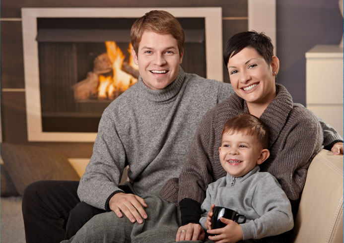 happy family near a working heater