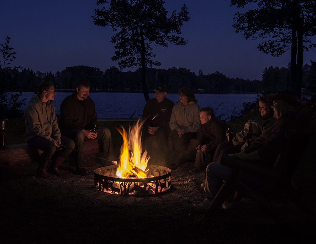 family by campfire