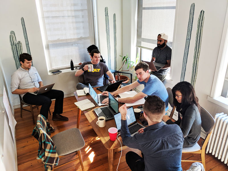 Appcues' product team sitting around a conference table for User Testing Day
