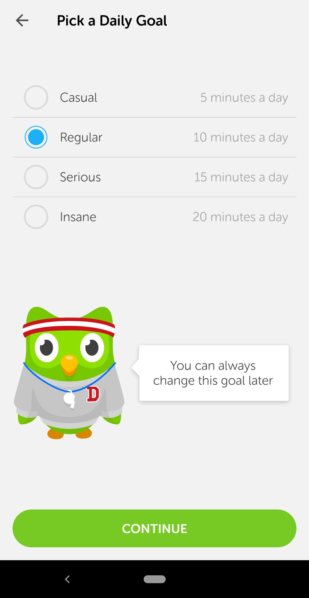 """This is a screenshot of Duolingo's onboarding process in which users are asked to set a goal. Goal setting is a powerful motivator in user onboarding. There is an owl in a sweatshirt and gym gear and the title says """"pick a daily goal""""."""