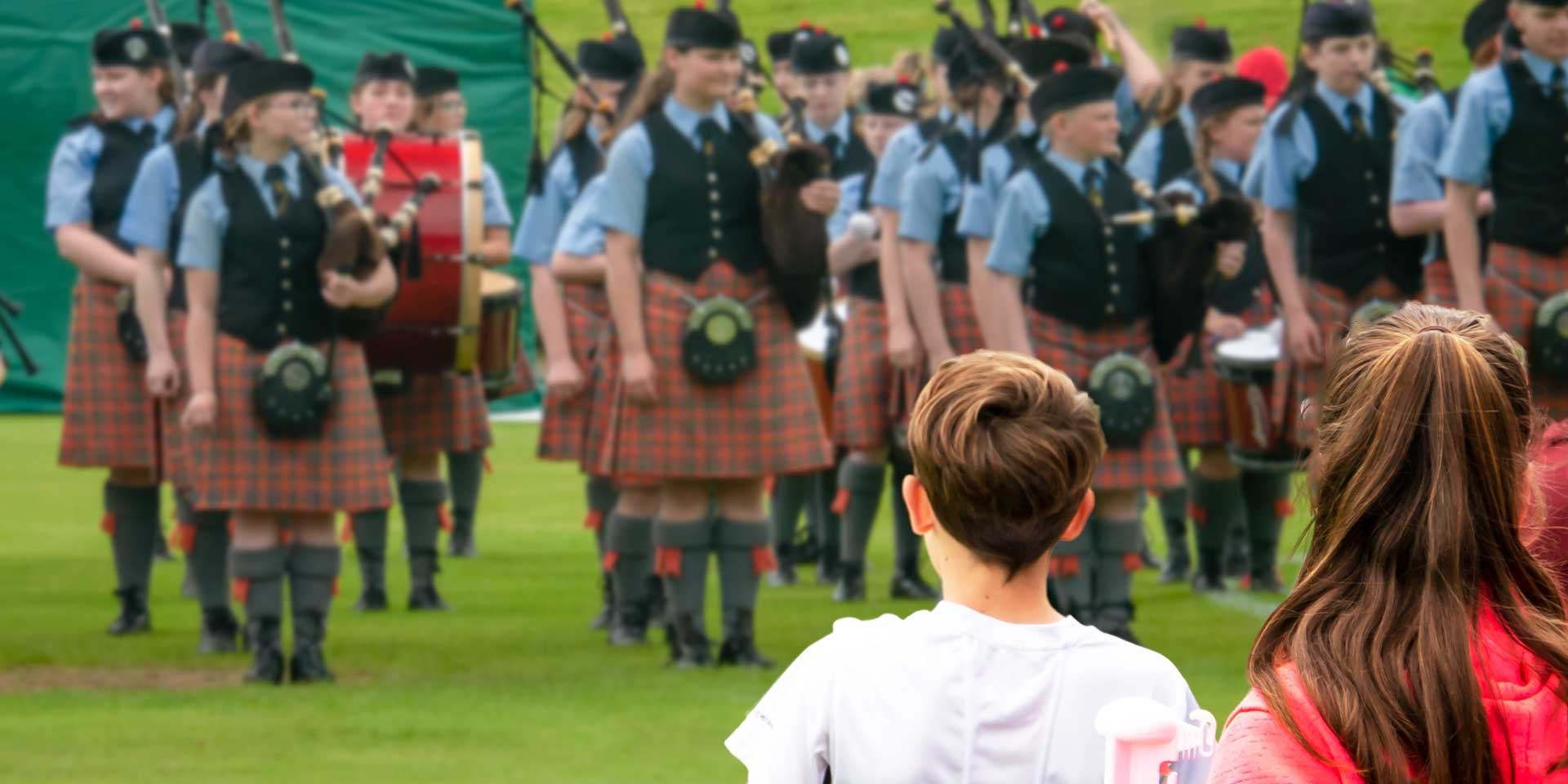 Oban High School Pipe Band entertain the crowds at the Oban Games