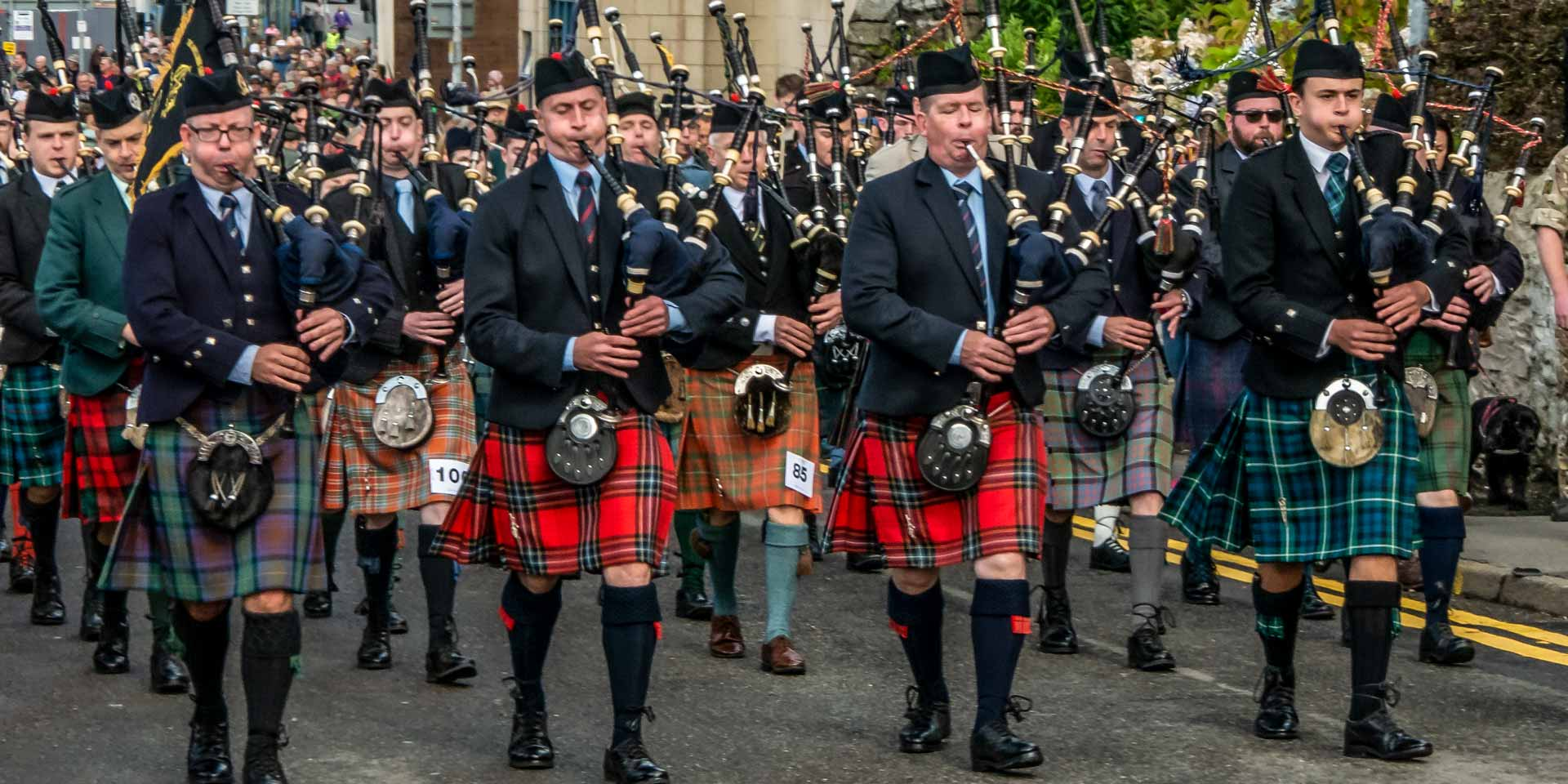 March of the competing pipers, led by the Gold Medal winner