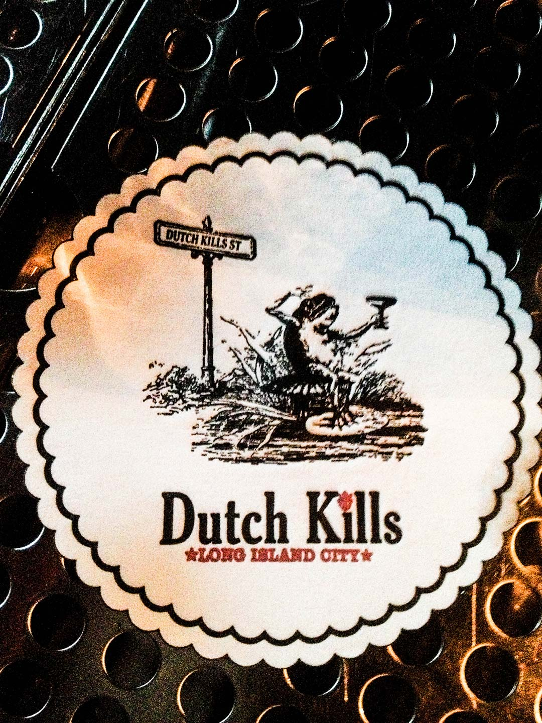 Dutch Kills frog with cocktail drink coaster letterpress printed with scalloped edges