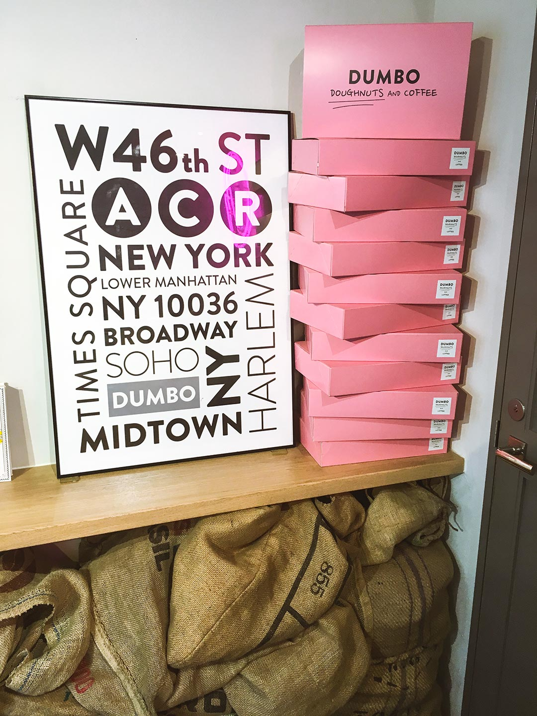 New York City posters and pink boxes at Dumbo Doughnuts in Azabujuban
