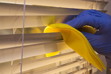 cleaning the blinds of a wichita home