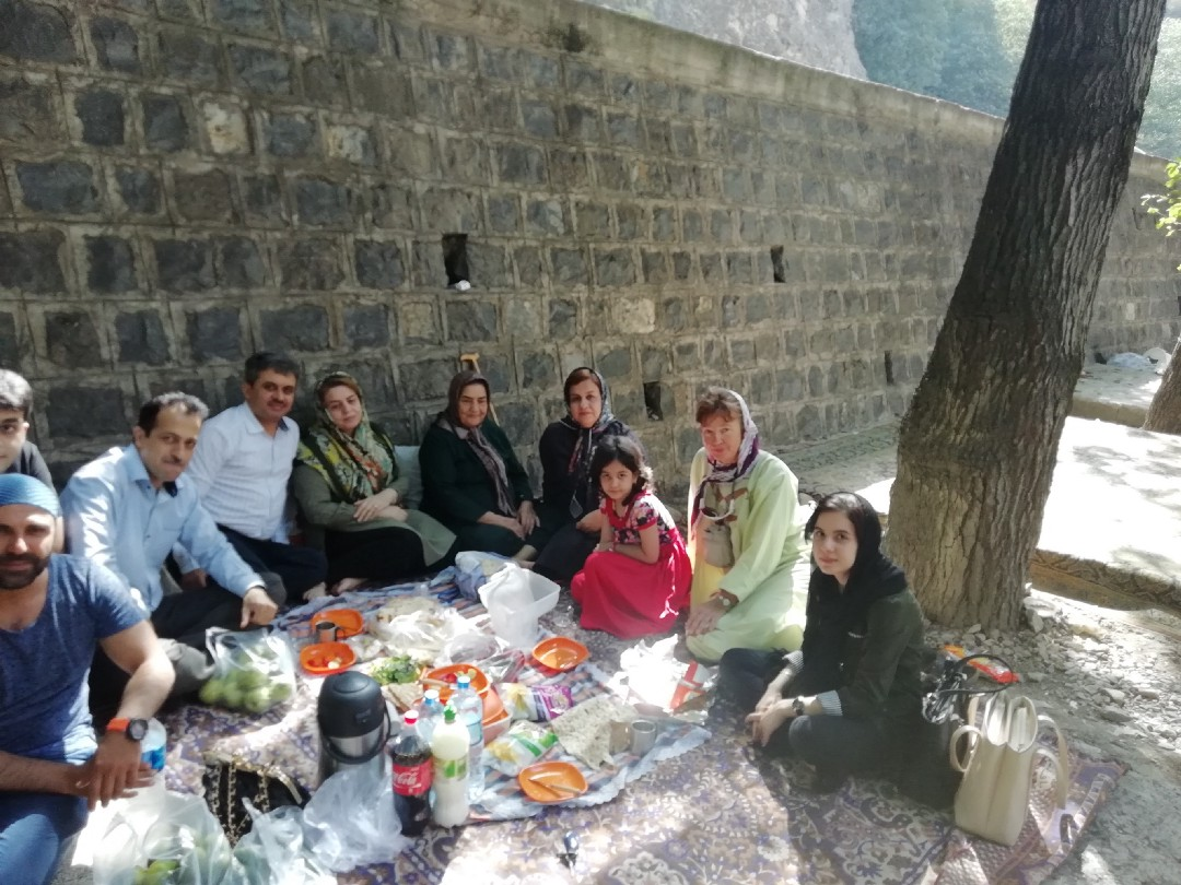 Mary Jane with picnickers beside a wall