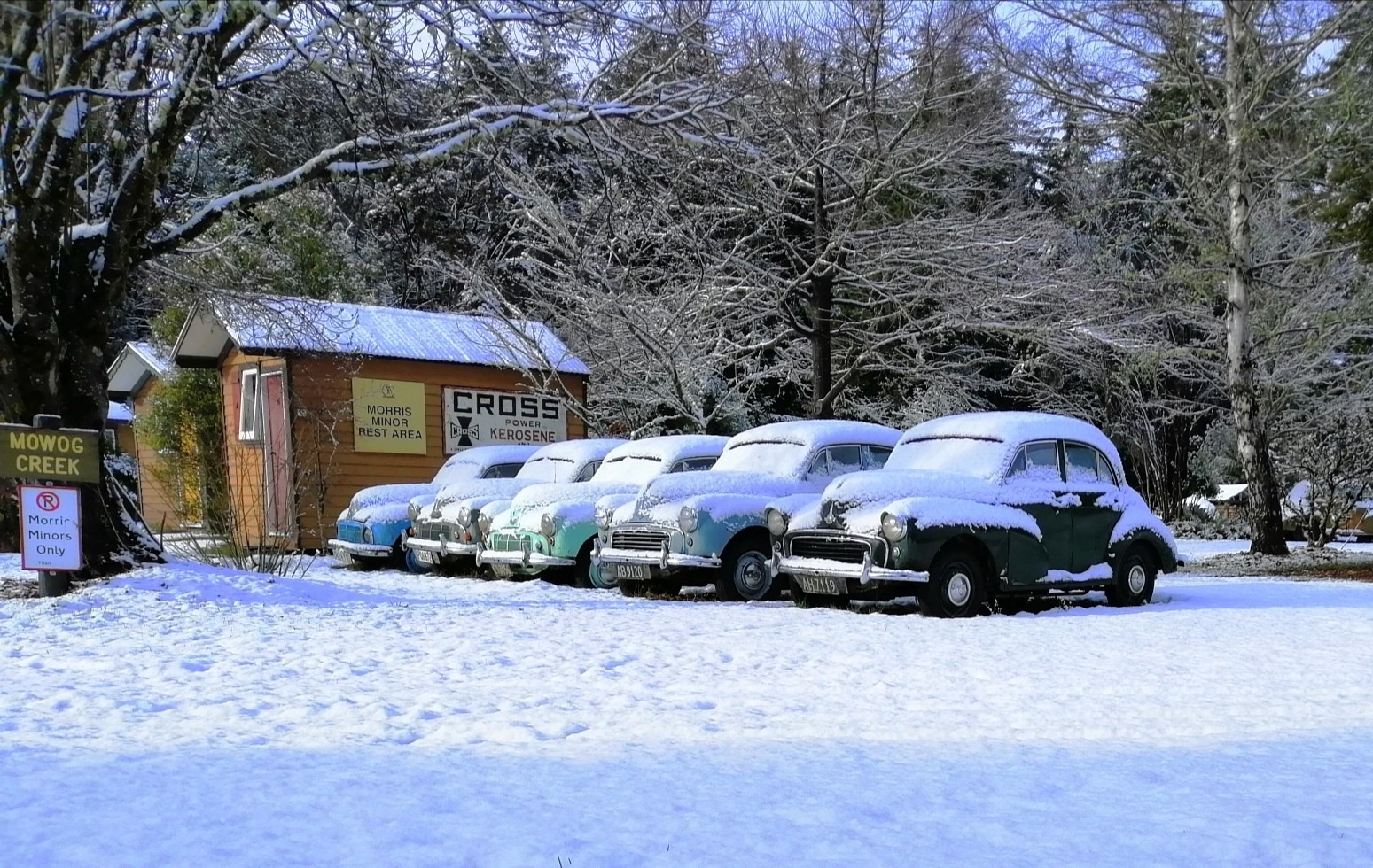 A row of Morris Minor cars in winter