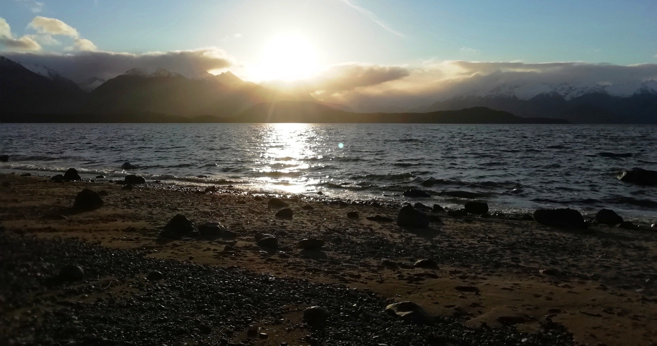 View of a sunset over the lake from Manapōuri township