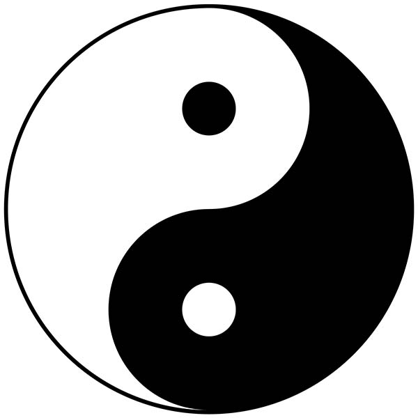 The traditional circular symbol for ying and yang with one half black and the other white, a symbol of Chinese Philosophy and the thinking behind Chinese Traditional medicine
