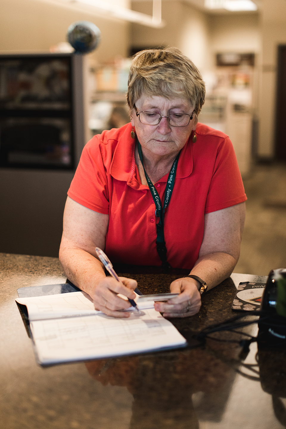 Woman filling out papers.