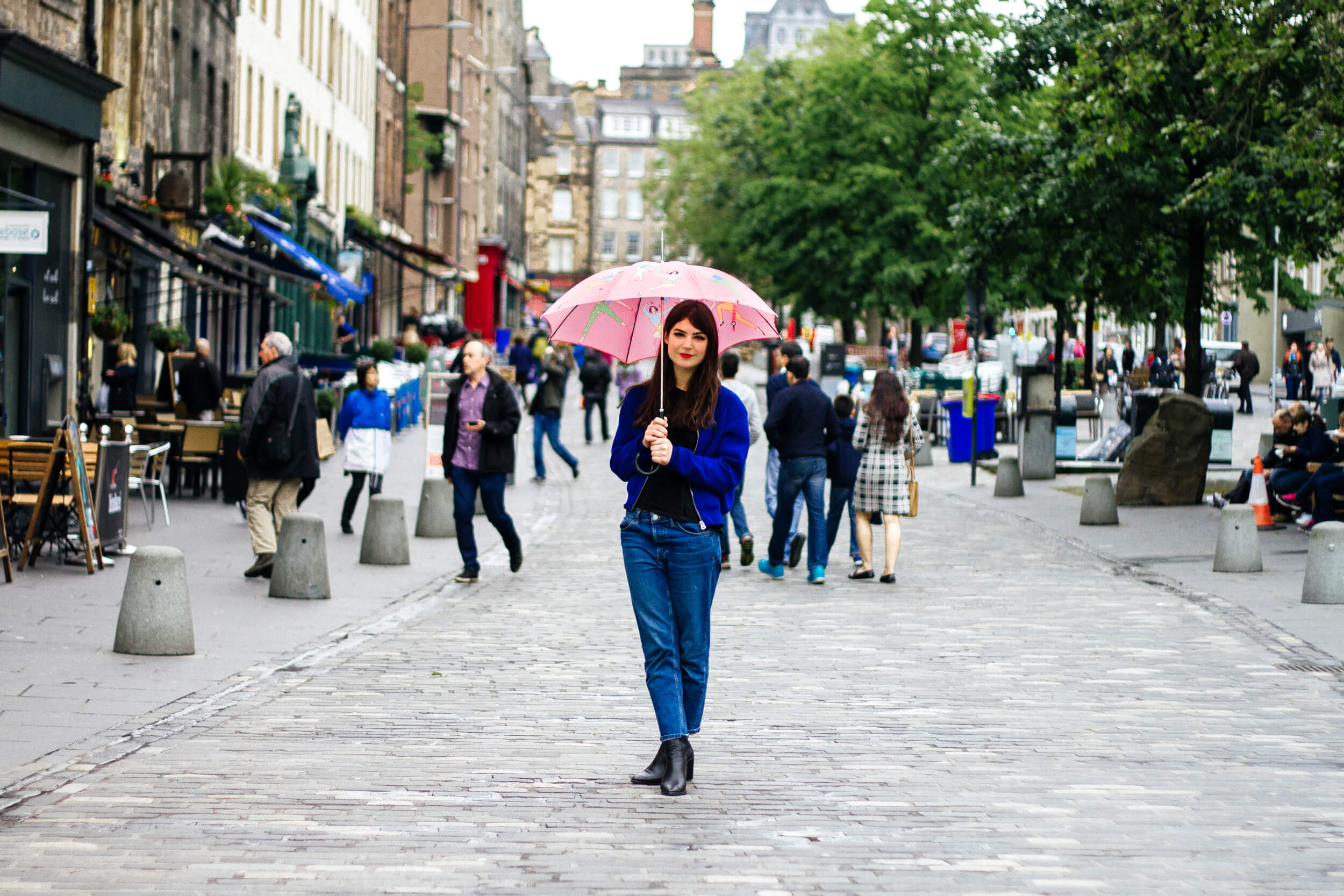 Karen Mabon in the Grassmarket, Edinburgh, with the Rain Dance umbrella - photo by Future Positive Studio