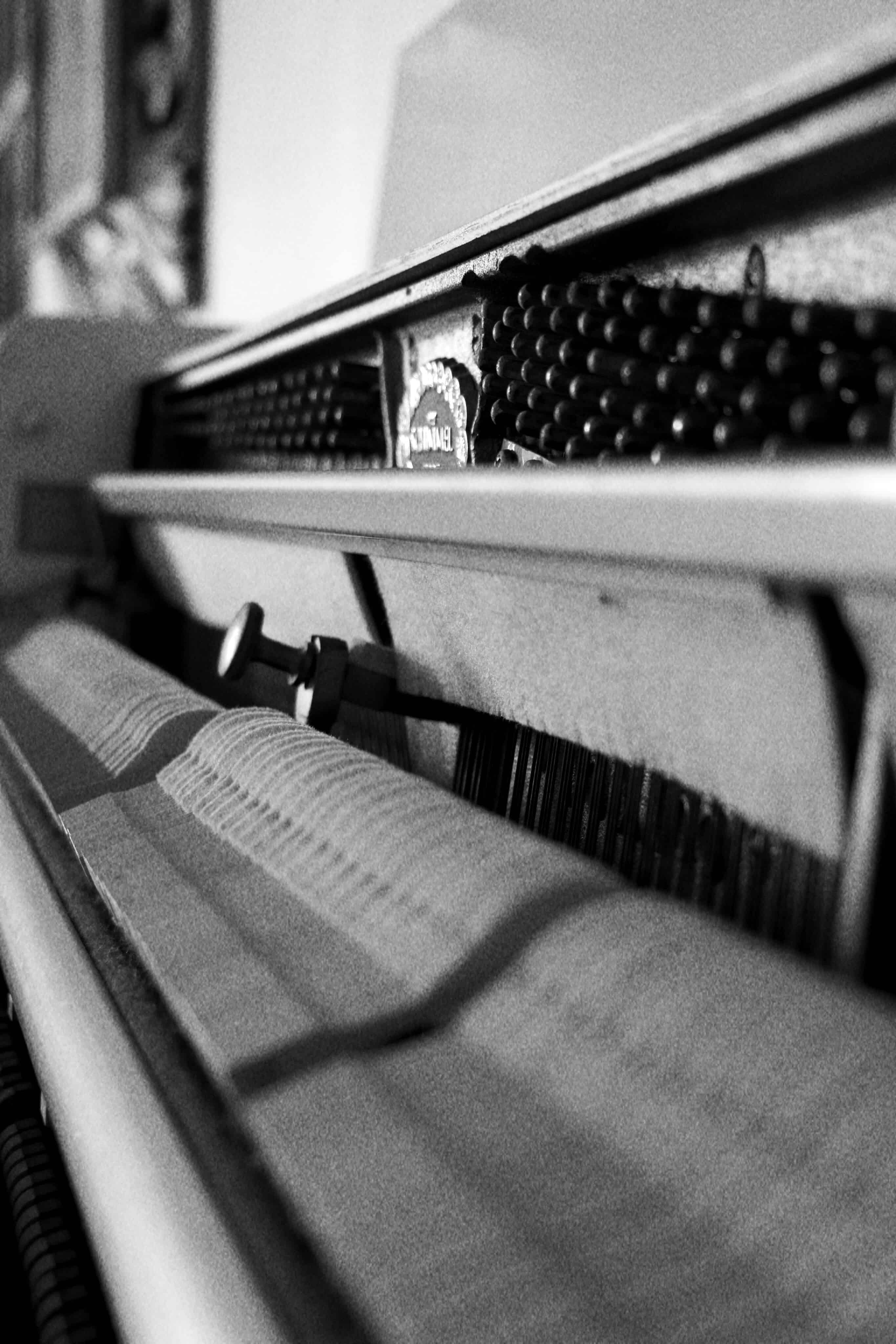 A black and white photograph of a piano