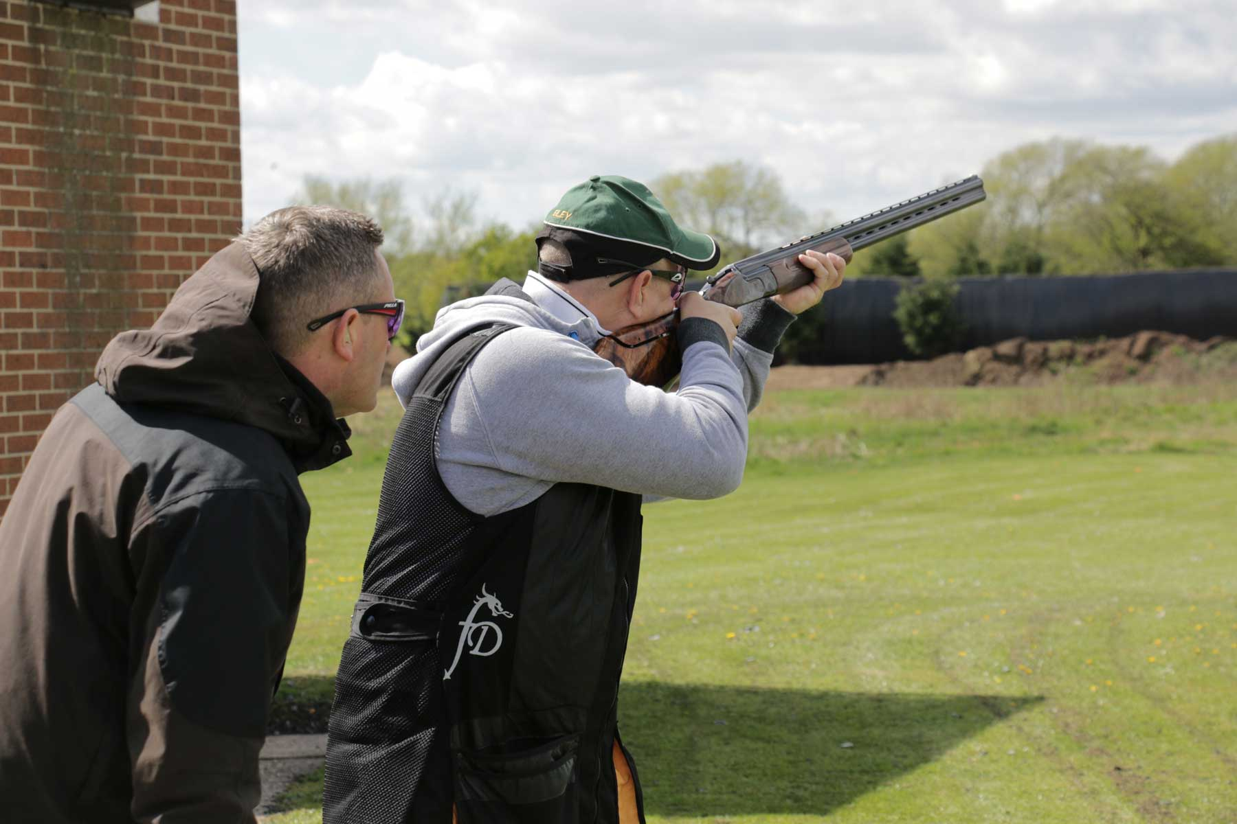 David Beardsmore and a client during a skeet shooting lesson