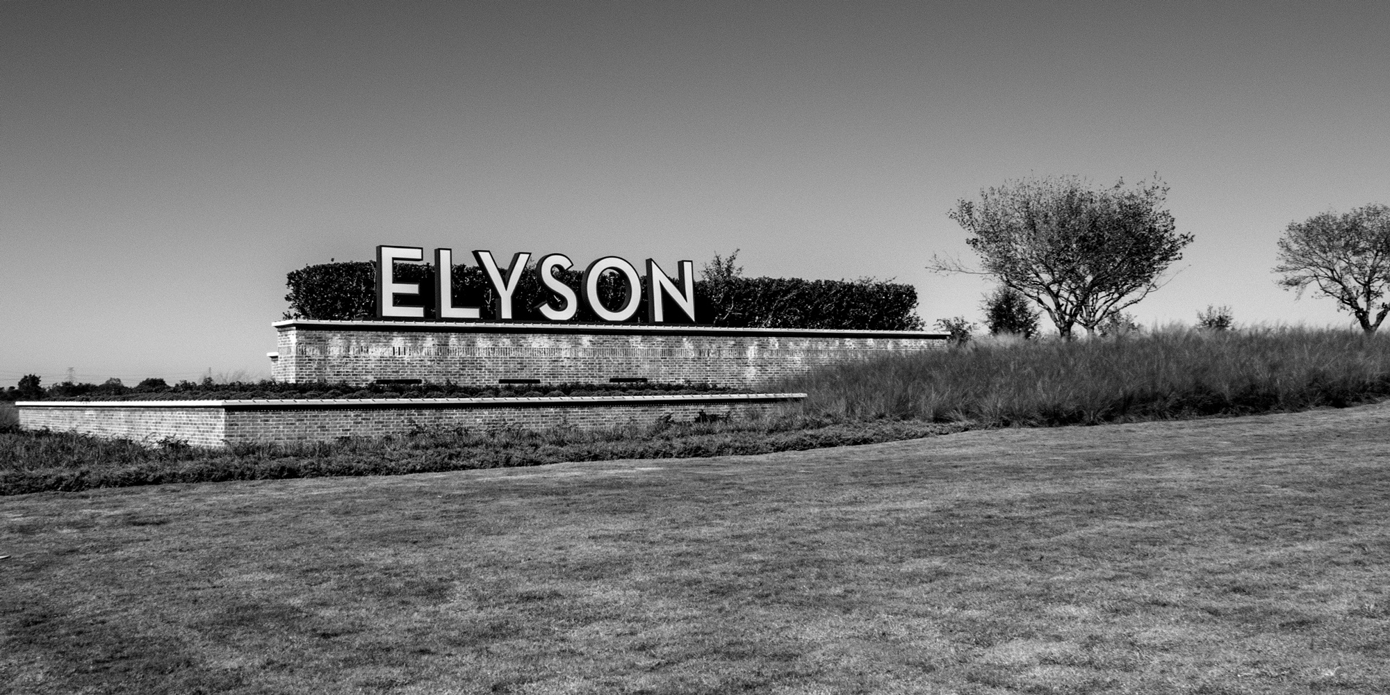 Elyson Community Gateway with large free standing fabricated and illuminated letters
