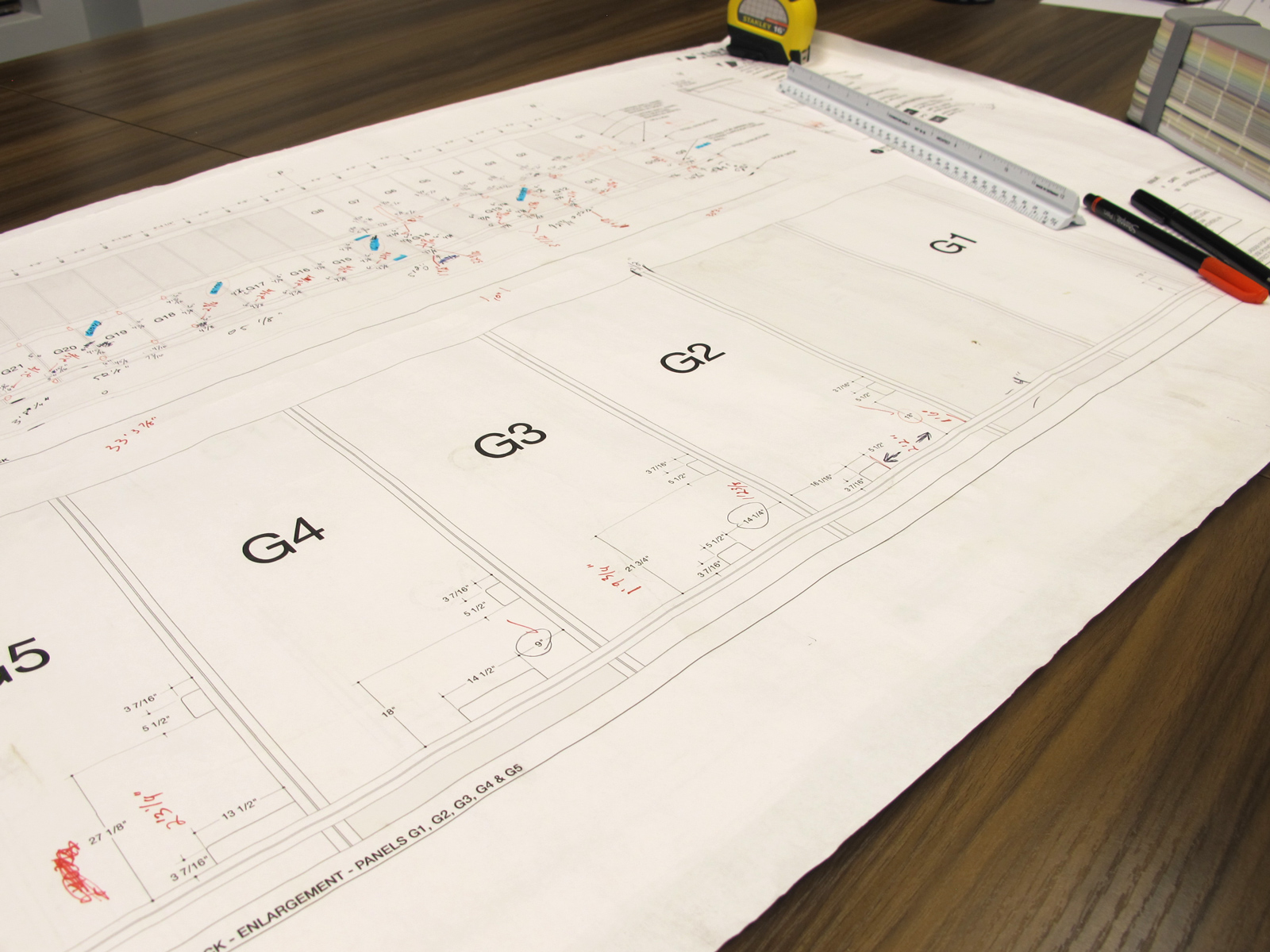 Project management construction drawings unrolled on table top
