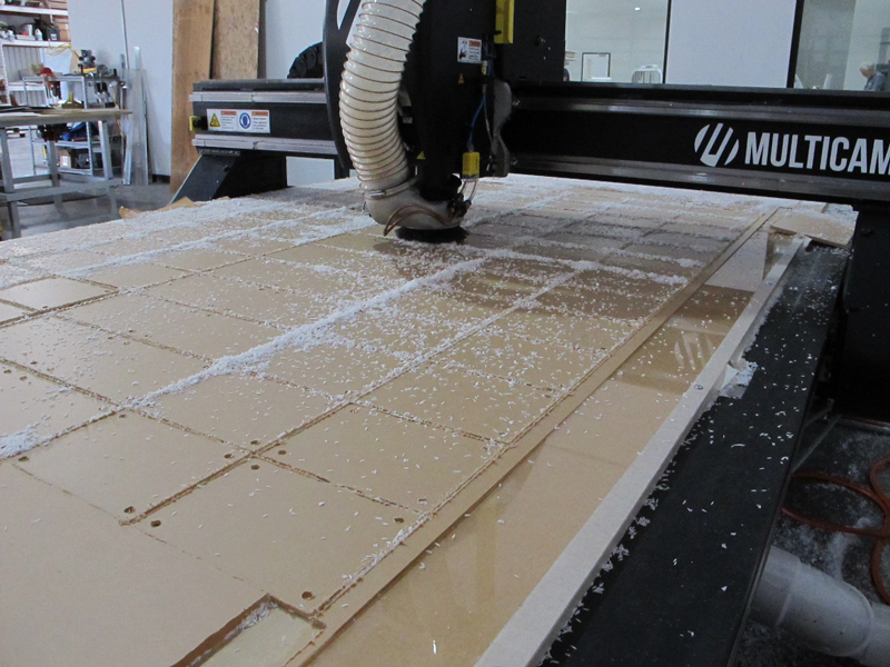 CNC router cutting signs out of acrylic sheet