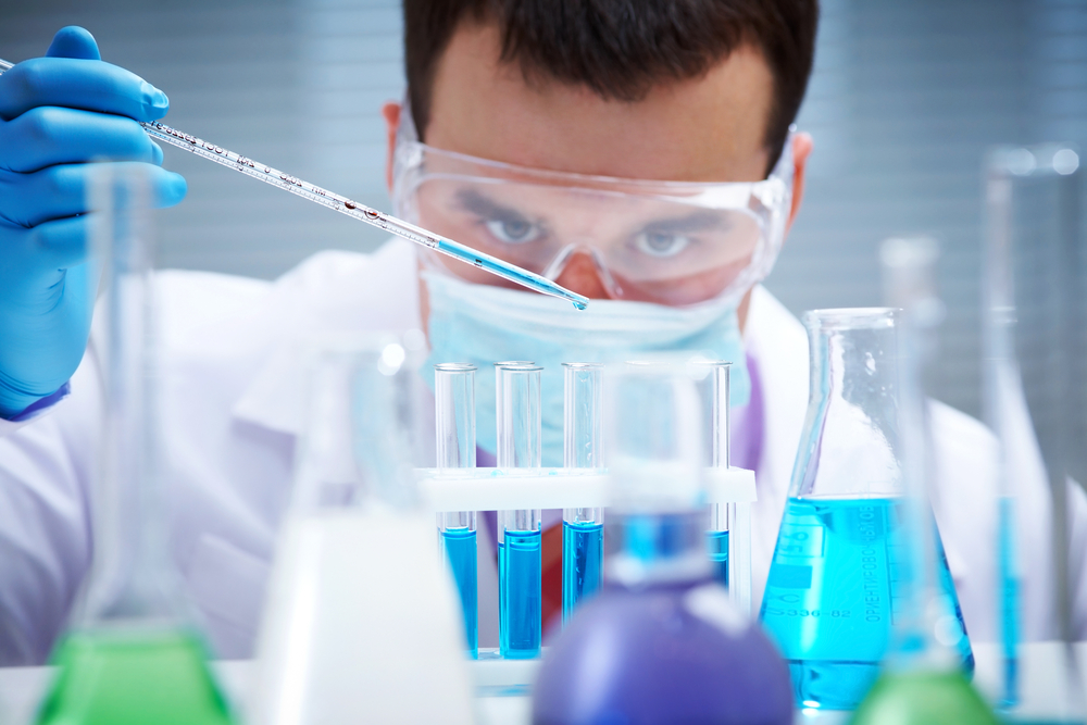 Pharmaceutical scientist working with chemicals.