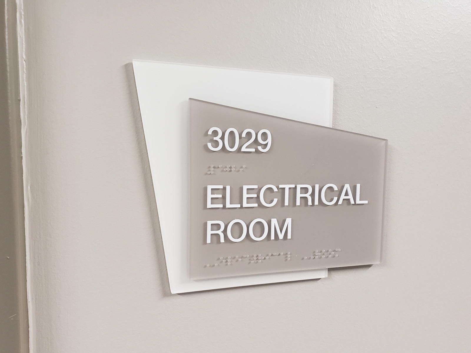 Custom interior room identification sign with tactile copy for The Heights Hospital.