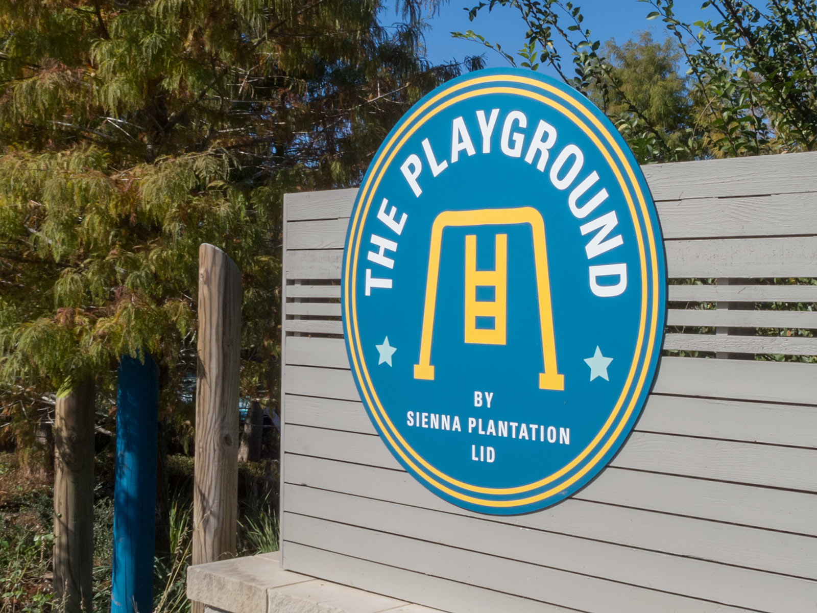 Close up of large-scale, dimensional logo with masked and painted graphics for Sienna Plantation playground monument.
