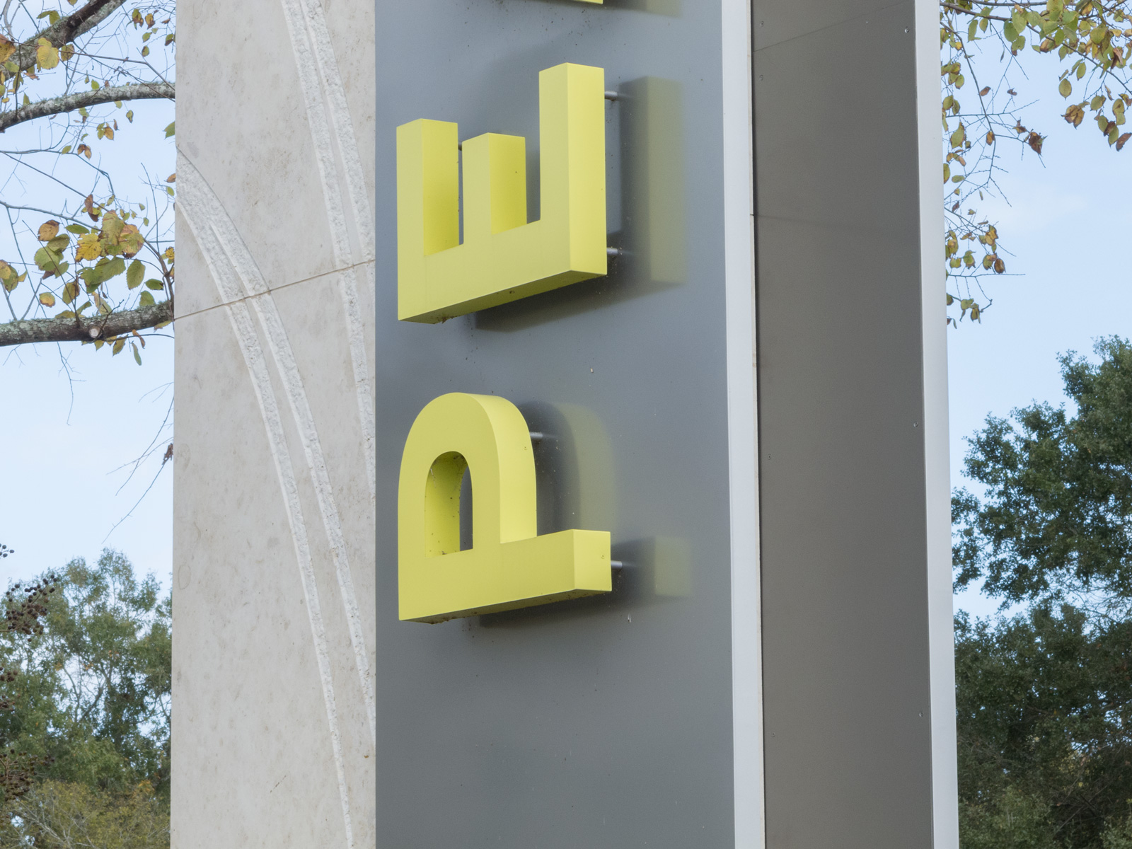 Close up of fabricated aluminum pans and custom fabricated halo-illuminated channel letters.