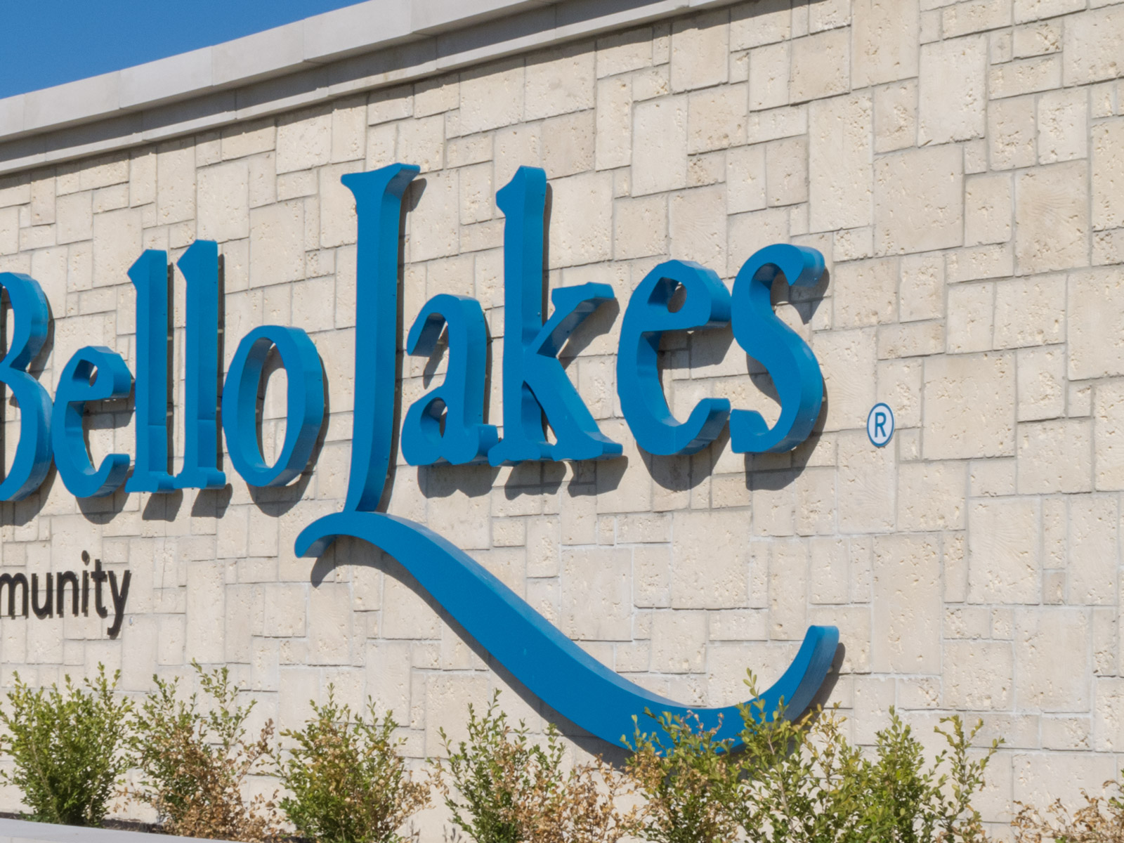 Close up of view of custom fabricated large scale, halo-illuminated channel letters.