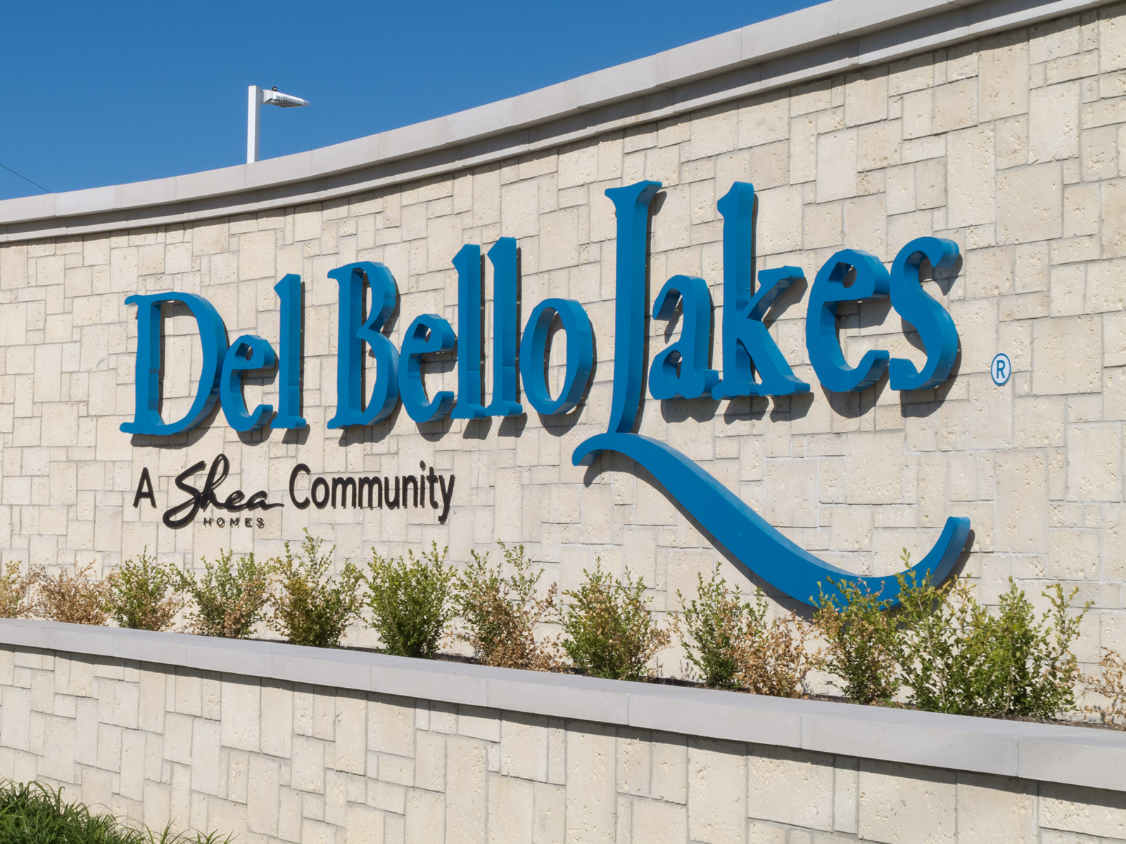Close up view of custom large scale, halo-illuminated channel letters and dimensional aluminum letters.