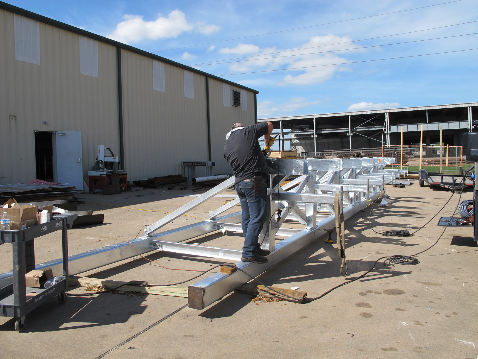 Final fabrication details of steel roof support of custom grand scale channel letters.