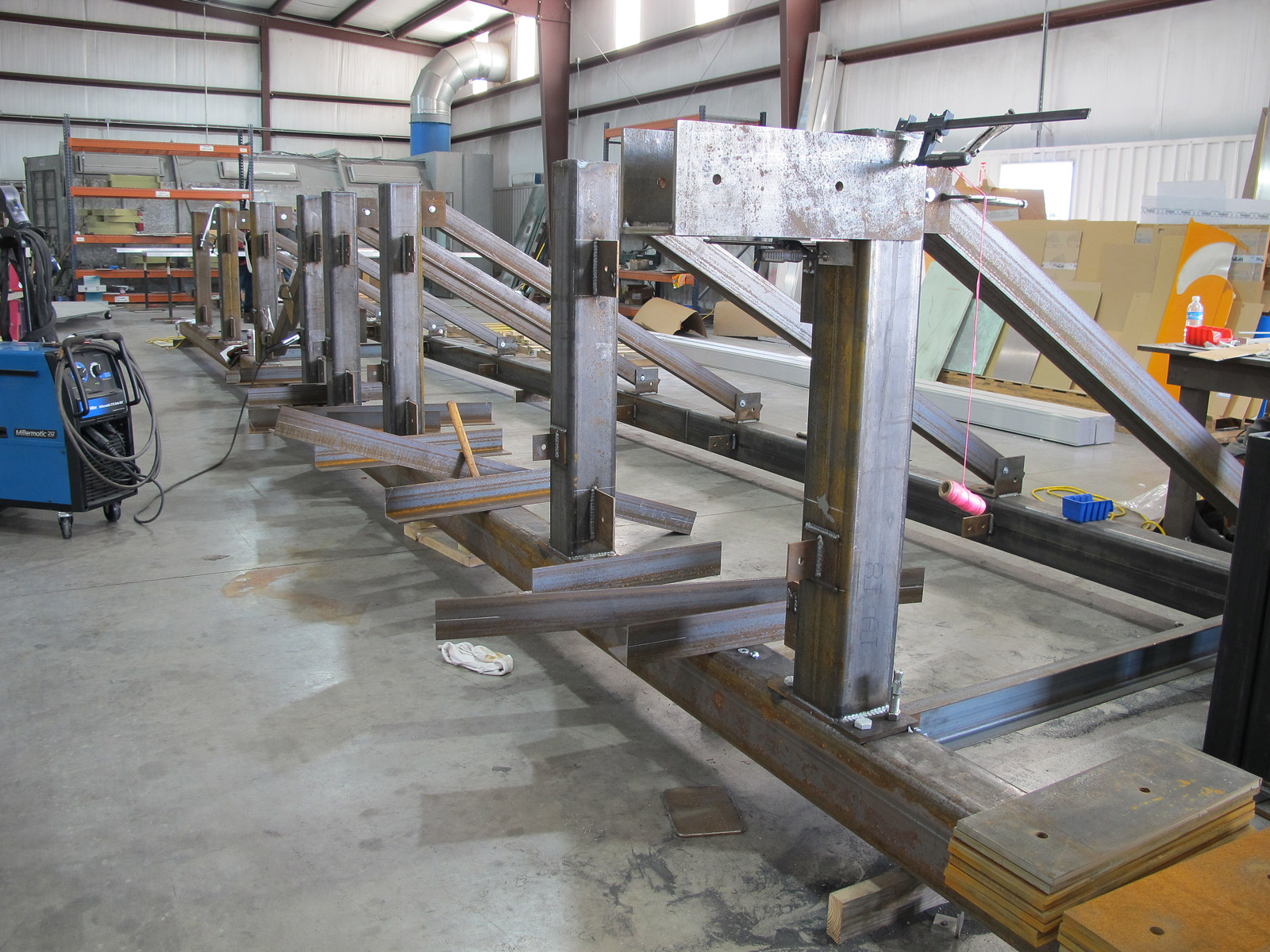 Steel roof support structure for custom channel letters for office tower in fabrication shop.