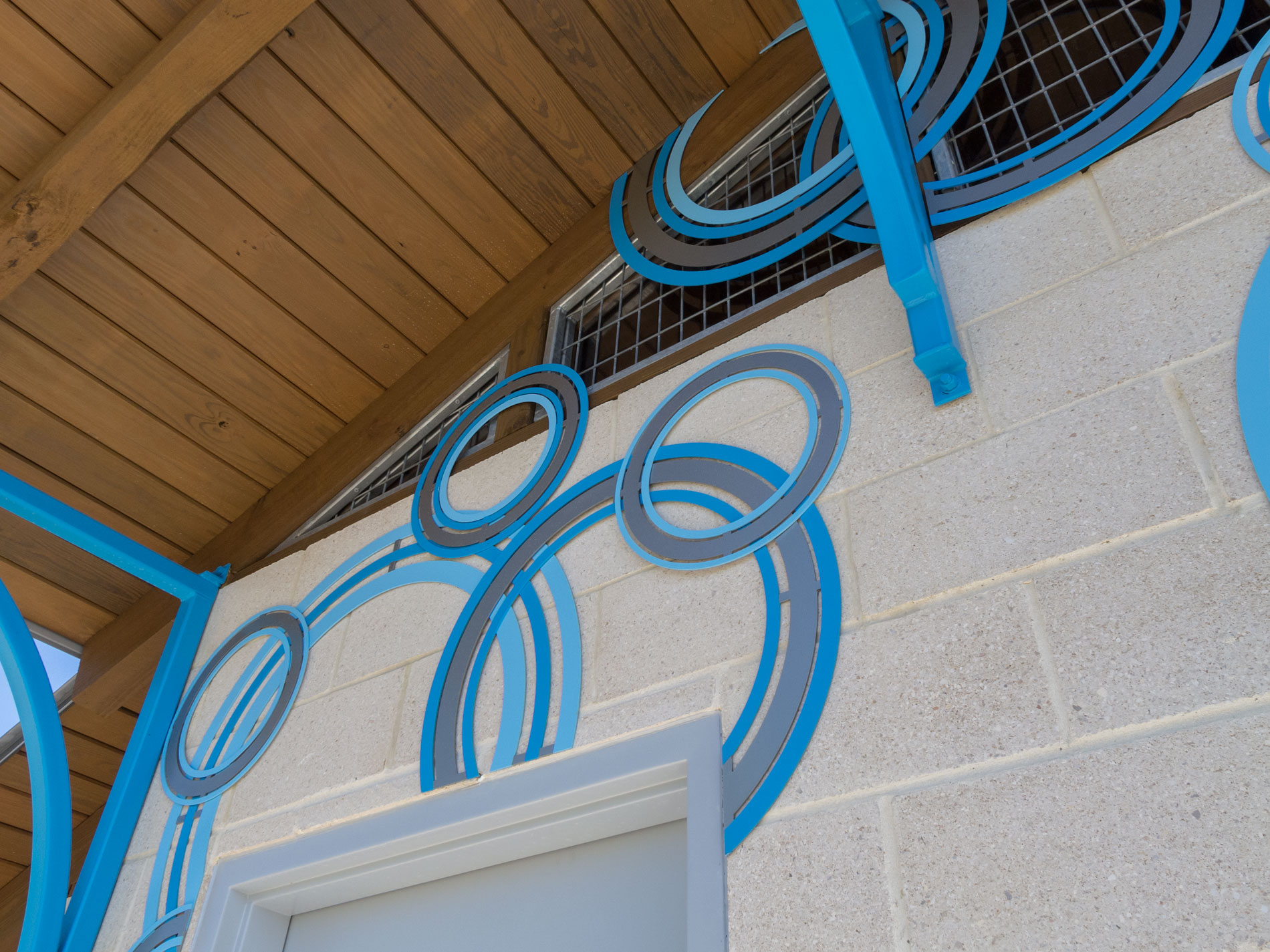 Close up view of custom cut, decorative multi-color aluminum rings.