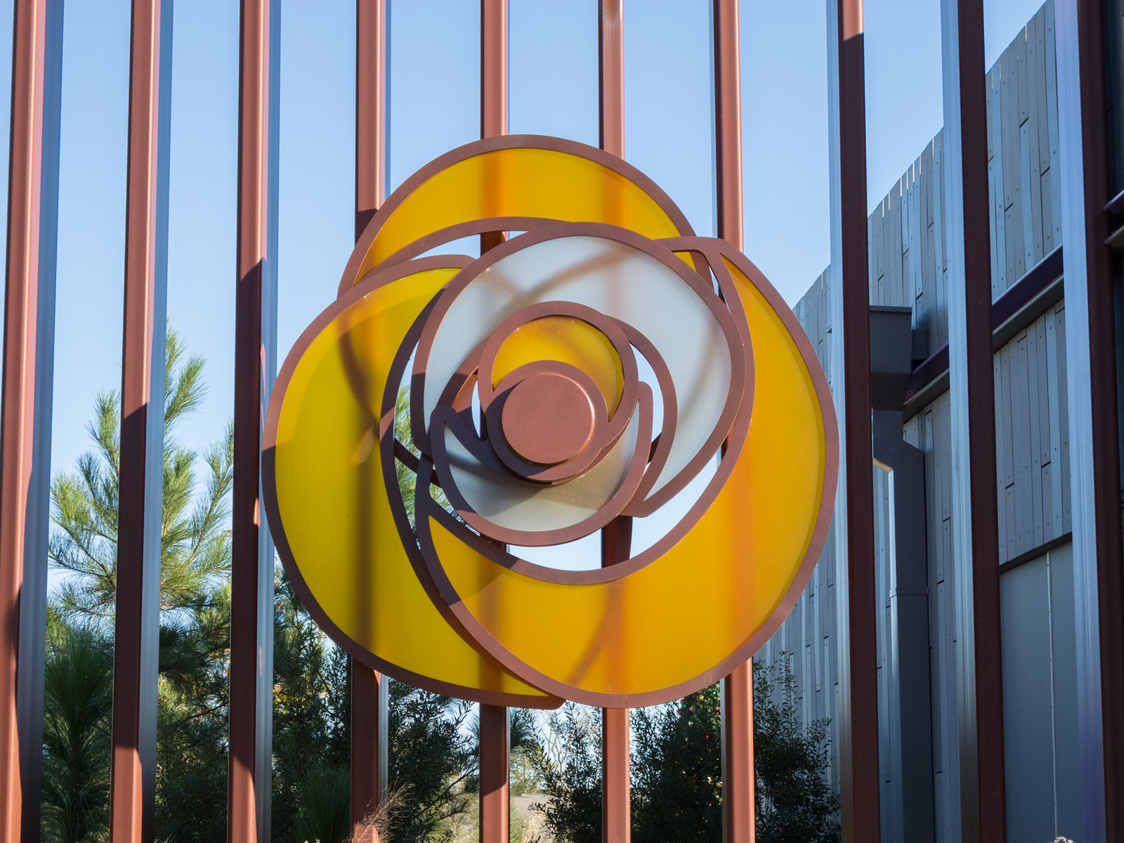 Close up view from front of custom fabricated rose sculpture with edge-lit 3Form petals.