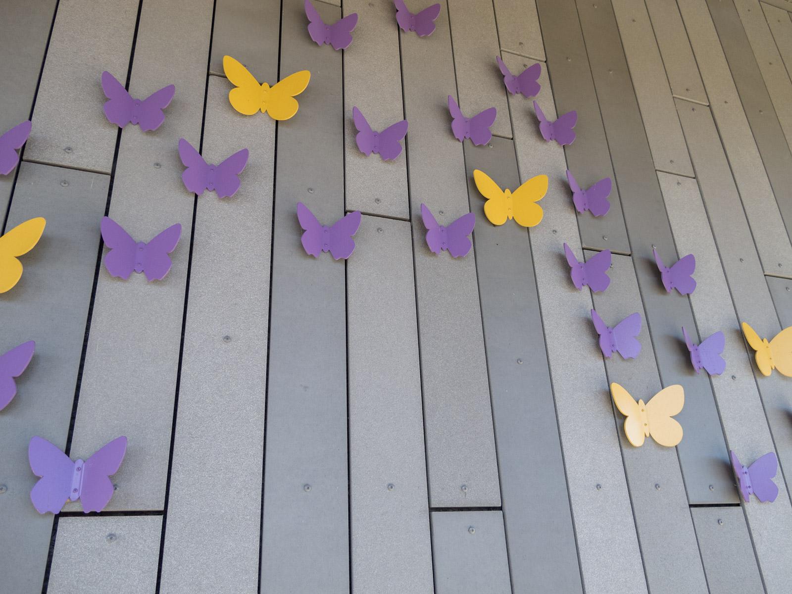 Close up view from below of custom dimensional aluminum butterflies.