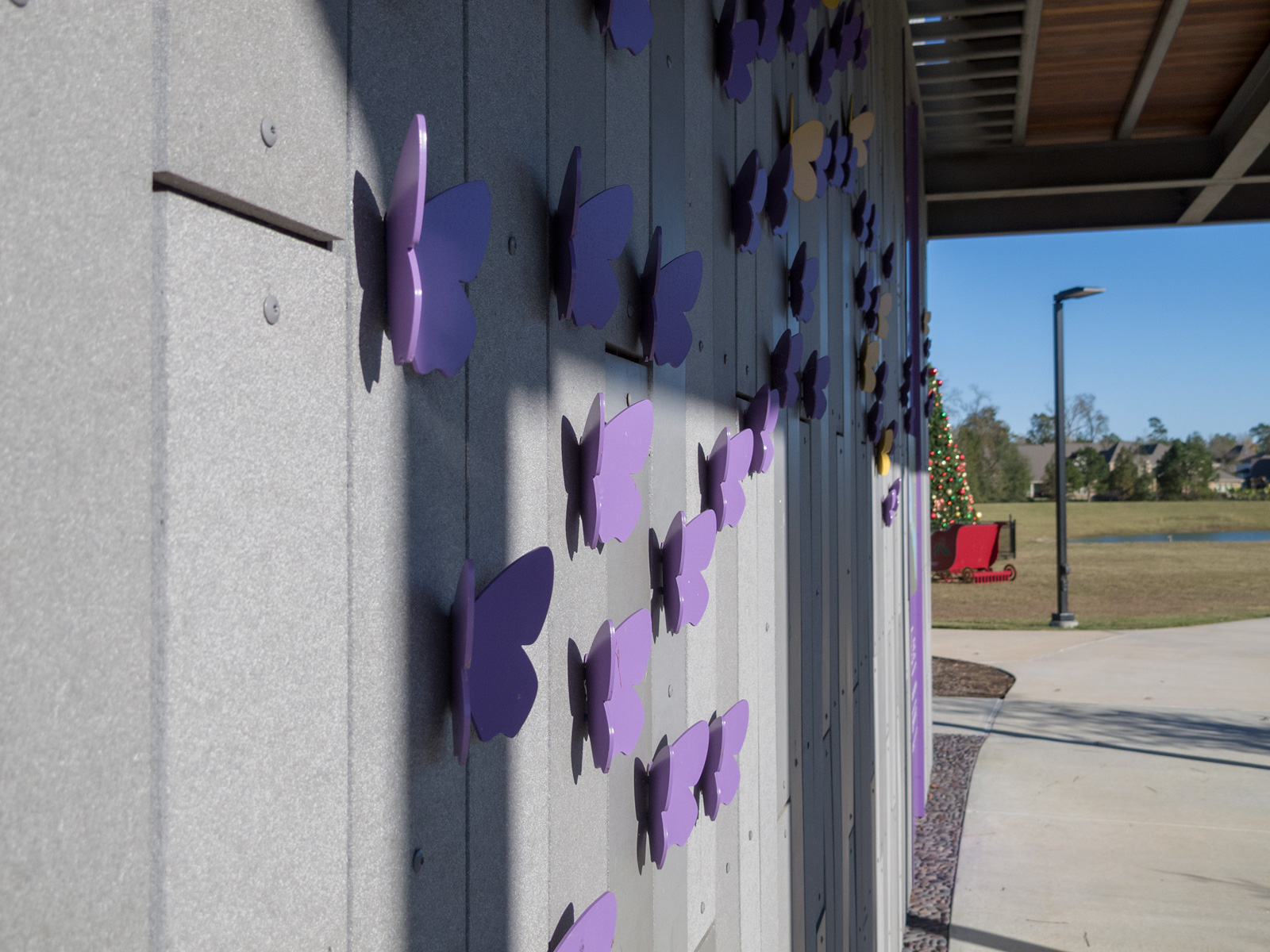 Close up view from side of custom dimensional aluminum butterflies.