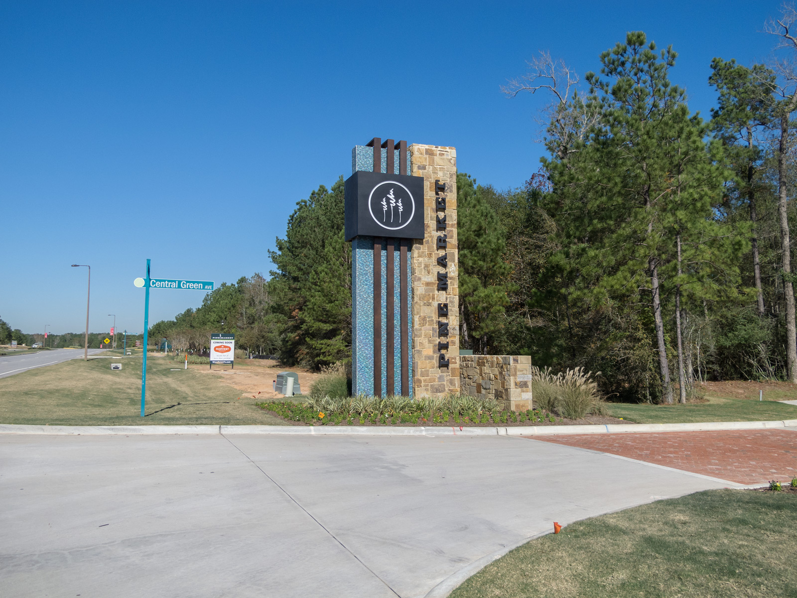 Front view of monument with illuminated sign cabinet with push through graphics, halo-illuminated channel letters, and fabricated accent bands.