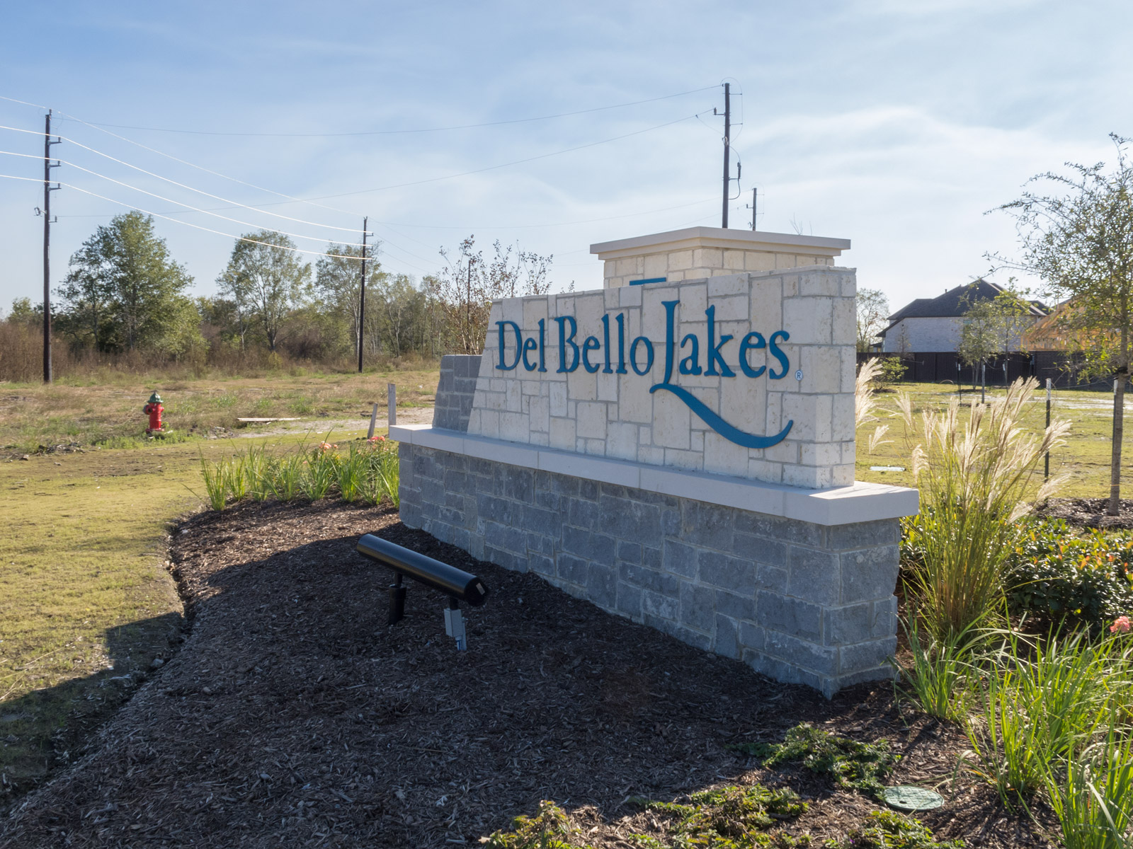 Custom dimensional aluminum letters and logo panel with painted graphics.