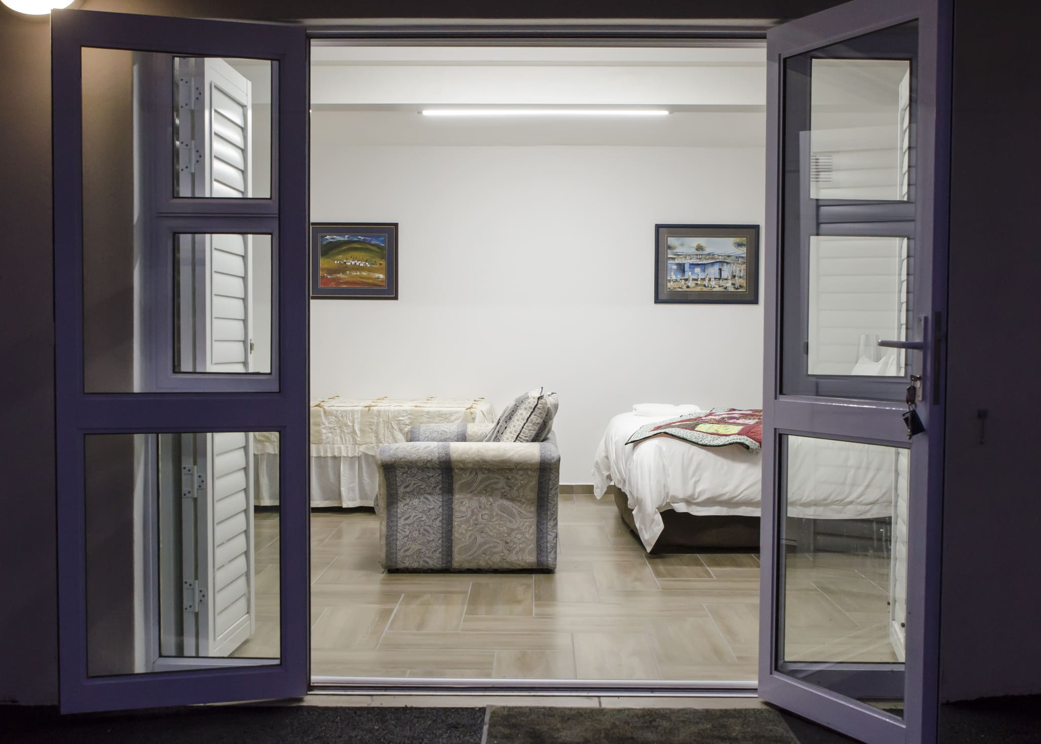 Take 5 room from the outside in through the open doors.