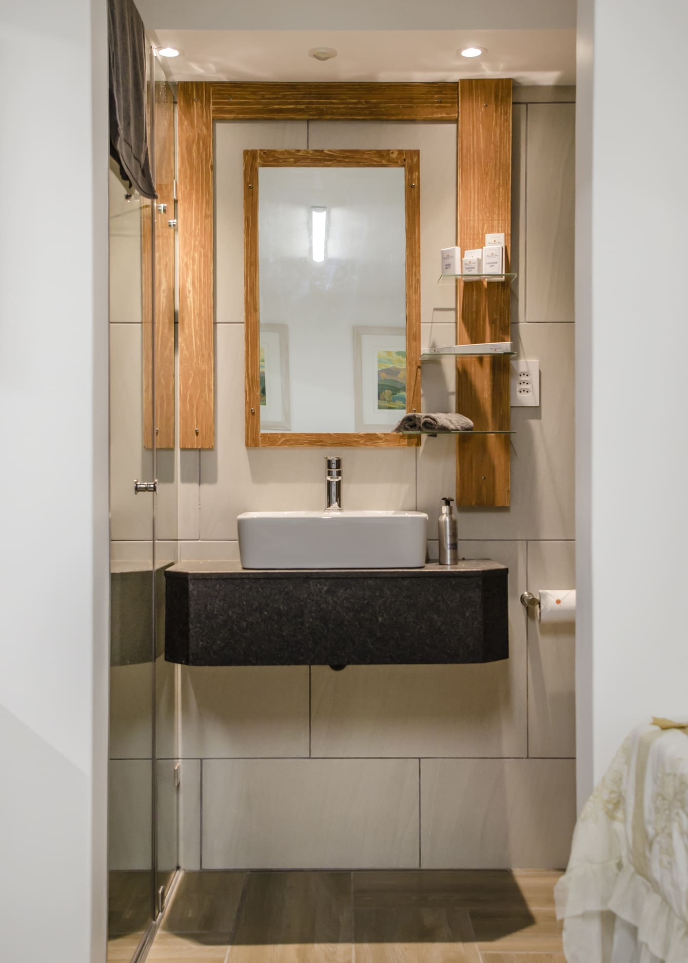 Photo of the bathroom in the Take 5 room showing the sink and main mirror.