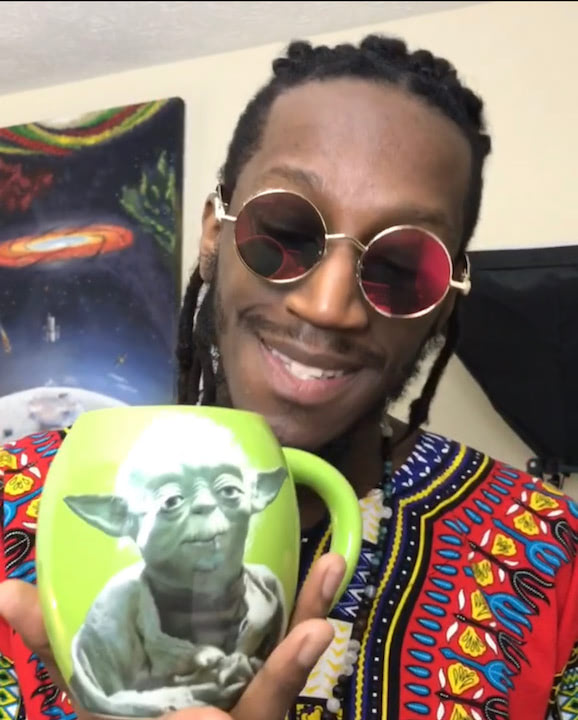 Mr. Wildenfree sips tea from his Yoda mug in a red dashiki, Feb. 22nd for February Flows