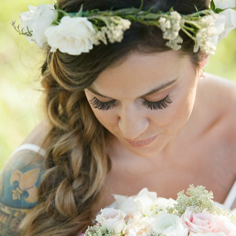 The bride wearing her floral crown.
